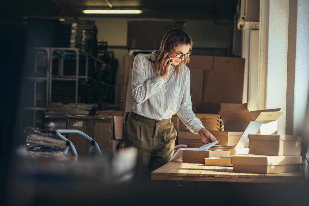 ecommerce; woman verifying online orders ready to ship